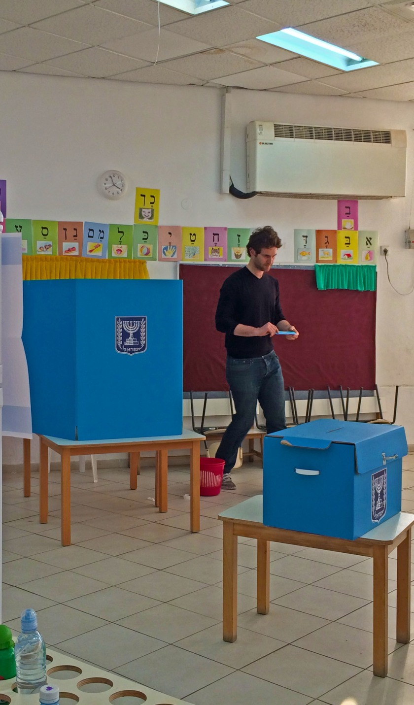 A young Israeli casting his vote.