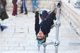 I completely fell in love with the little boys at the Western Wall who started hamming it up when they realized I was taking their pictures. The paper crowns that they're wearing means they are being given their first prayer books during a ceremony at the Western Wall, among Judaism's holiest of sites.