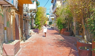 on a gorgeous street in Keren Hateimanim, I had to have my friend Loren take this photo of me.