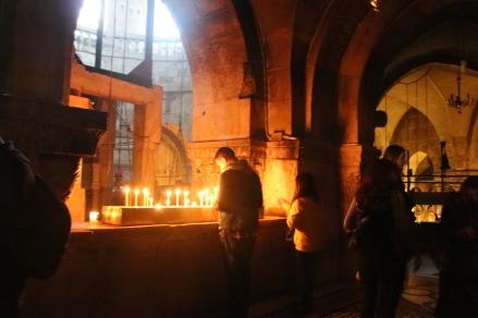 Pilgrim at the Church of the Holy Sepulchre's Roman Catholic Chapel.