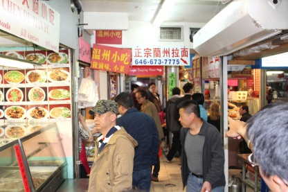 People peruse different vendors at the Golden Shopping Mall.