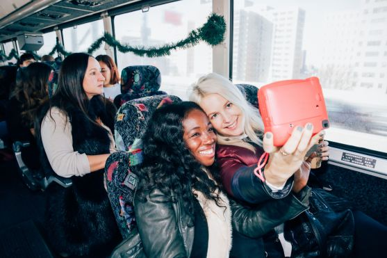 """The """"Shopping Sleigh"""" was fully equipped with champagne, fresh juice, snacks and fun polaroids and props!"""